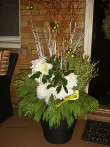 outdoor christmas arrangement white green