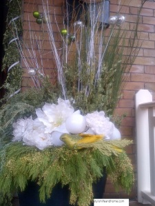 sparkling outdoor christmas arrangement white yellow green