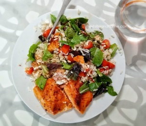 baked salmon with side of rice and mixed greens