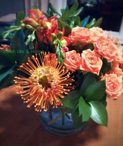 contemporary floral design orange pincushion tea roses freesia