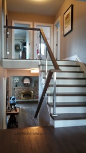 hallway with contemporary glass railing white oak cap