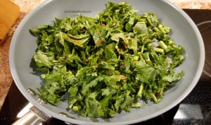 rapini chopped in sautee pan red chillies