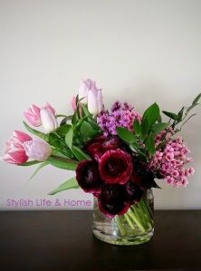 ranunculus wax flower pink tulips red purple dramatic floral arrangement contemporary stylish